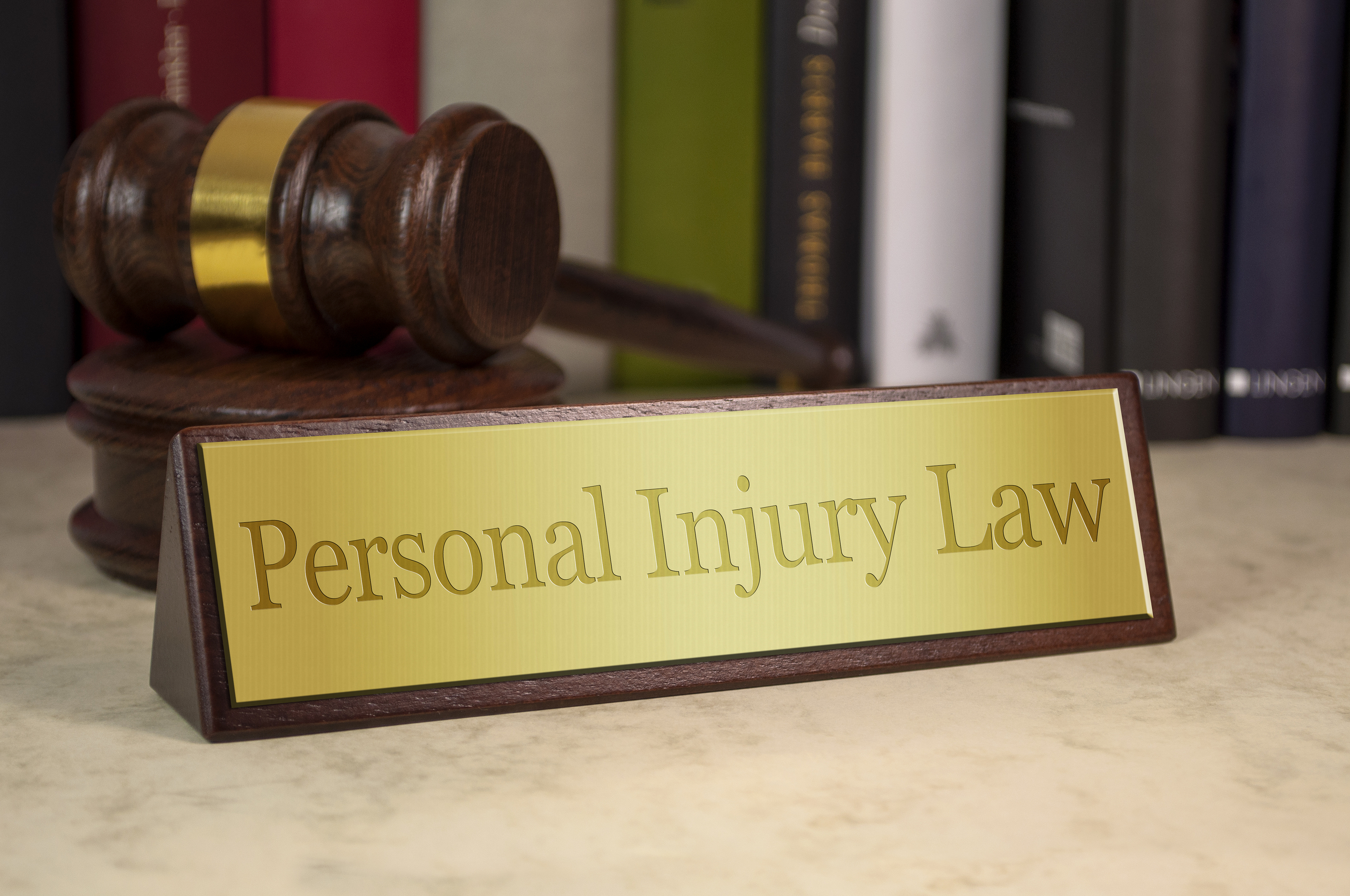 Denver Personal Injury Attorney personal injury law name plaque - About Us Photo